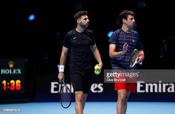 Marcel Granollers of Spain looks on with partner Horacio Zeballos of Argentina during their doubles match against John Peers of Australia and Michael...