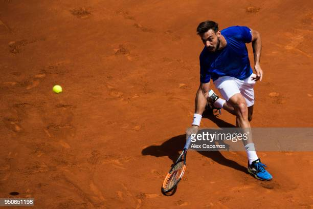 Marcel Granollers of Spain plays a backhand against David Goffin of Belgium in their match during day three of the Barcelona Open Banc Sabadell on...