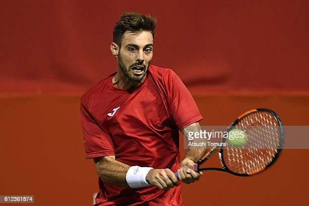 Marcel Granollers of Spain plays a backhand during the men's singles first round match against Marcos Baghdatis of Cyprus on day two of Rakuten Open...