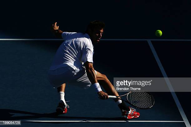 Marcel Granollers of Spain plays a backhand in his first round match against Matthew Ebden of Australia during day two of the Sydney International at...