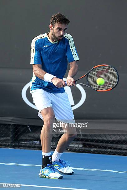 Marcel Granollers of Spain plays a backhand in his first round match against Dudi Sela of Israel on day one of the 2017 Australian Open at Melbourne...