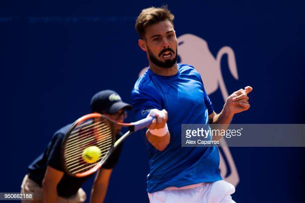 Marcel Granollers of Spain plays a forehand against David Goffin of Belgium in their match during day three of the Barcelona Open Banc Sabadell on...