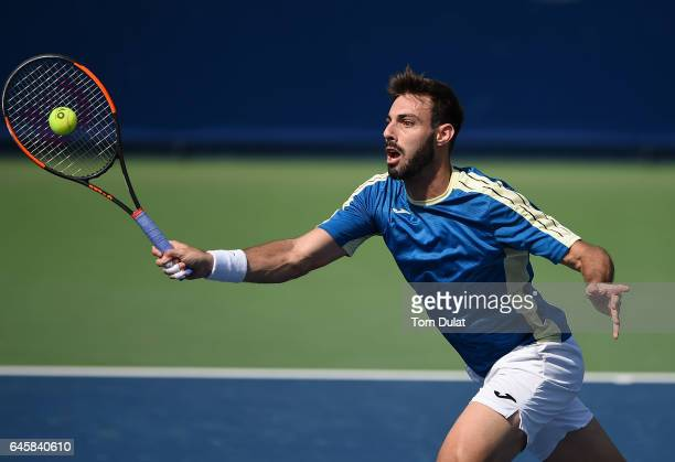 Marcel Granollers of Spain plays a forehand during his match against Jiri Vesely of Czech Republic on day two of the ATP Dubai Duty Free Tennis...