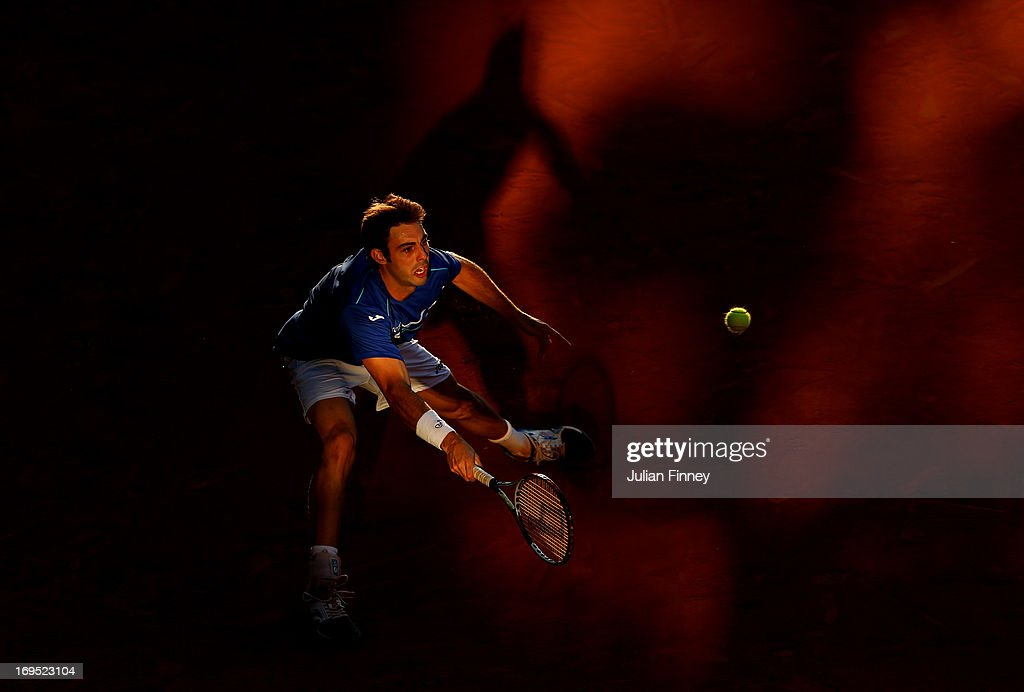 Marcel Granollers of Spain plays a forehand during his men's singles match against Feliciano Lopez of Spain on day one of the French Open at Roland Garros on May 26, 2013 in Paris, France.