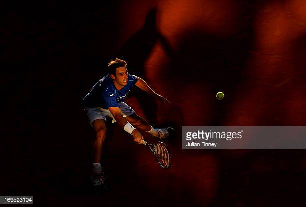 Marcel Granollers of Spain plays a forehand during his men's singles match against Feliciano Lopez of Spain on day one of the French Open at Roland...