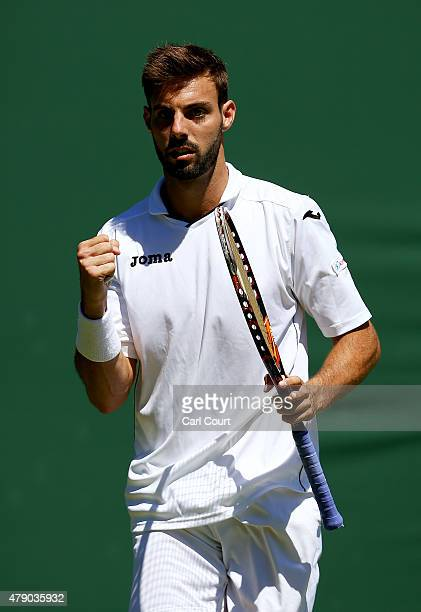 Marcel Granollers of Spain reacts in his Mens Doubles match with Marc Lopez against Mateusz Kowalczyk and Igor Zelenay during day two of the...