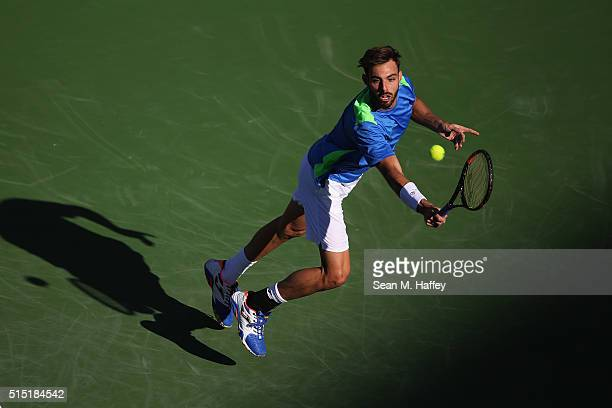 Marcel Granollers of Spain returns a shot against Andy Murray of Great Britain during the BNP Paribas Open at the Indian Wells Tennis Garden on March...