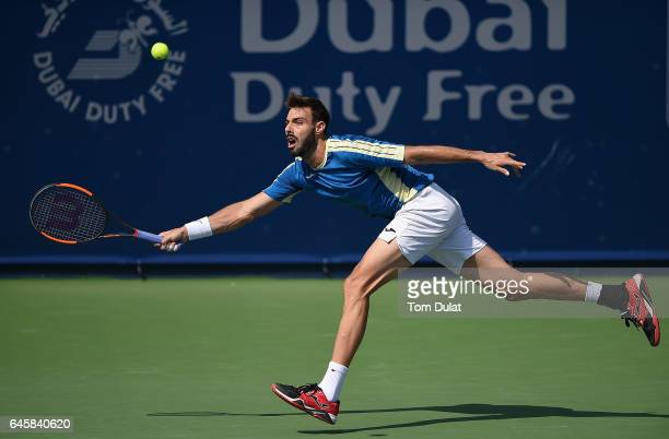 Marcel Granollers of Spain returns a shot during his match against Jiri Vesely of Czech Republic on day two of the ATP Dubai Duty Free Tennis...