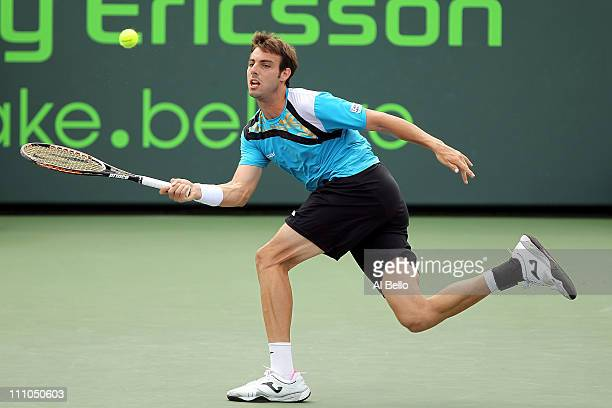 3e7041a2b Marcel Granollers of Spain returns against David Ferrer of Spain during the  Sony Ericsson Open at