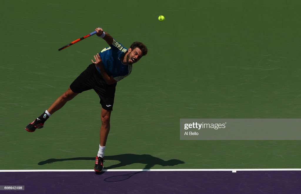 Marcel Granollers of Spain serves against Borna Coric of Croatia during Day 4 of the Miami Open at Crandon Park Tennis Center on March 23, 2017 in Key Biscayne, Florida.