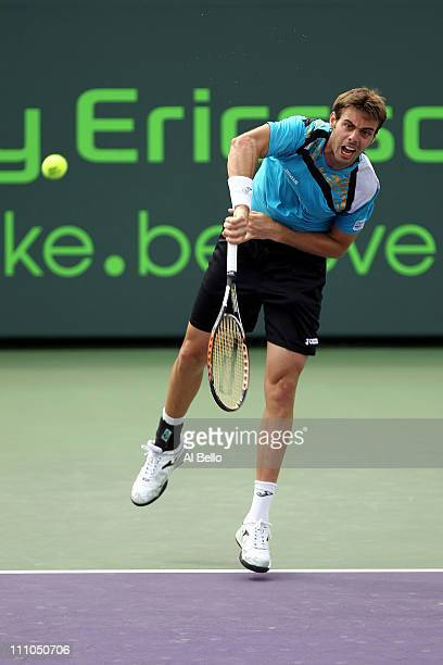 19c5a06e1 Marcel Granollers of Spain serves against David Ferrer of Spain during the  Sony Ericsson Open at