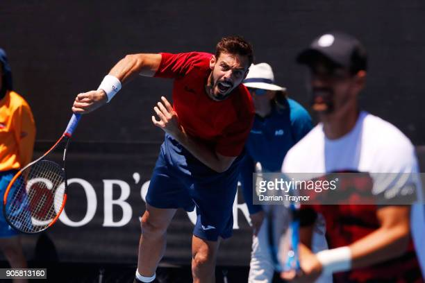 Marcel Granollers of Spain serves in his first round men's doubles match with Fabio Fognini of Italy against Alex Bolt of Australia and Bradley...