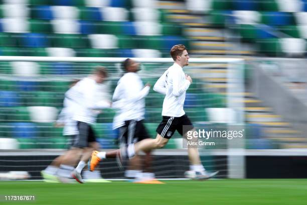 Marcel Halstenberg and team mates run during a Germany training session ahead of the UEFA Euro 2020 qualifier match between Northern Ireland and...