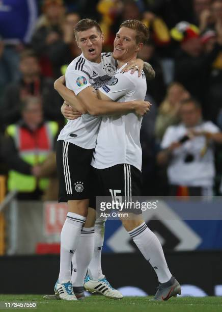 Marcel Halstenberg of Germany celebrates his team's first goal with team mate Toni Kroos during the UEFA Euro 2020 qualifier match between Northern...
