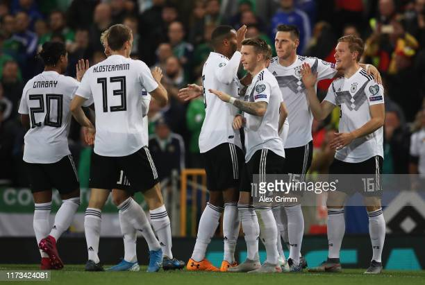 Marcel Halstenberg of Germany celebrates with teammates after scoring his team's first goal during the UEFA Euro 2020 qualifier match between...