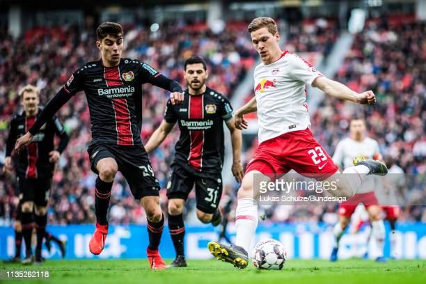 Marcel Halstenberg of Leipzig and Kai Havertz of Leverkusen in action during the Bundesliga match between Bayer 04 Leverkusen and RB Leipzig at...