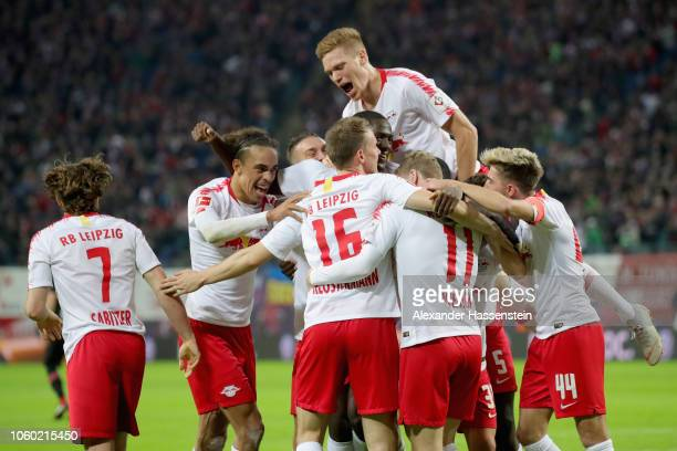 Marcel Halstenberg of Leipzig celebrates with his team mates the 3rd team goal during the Bundesliga match between RB Leipzig and Bayer 04 Leverkusen...