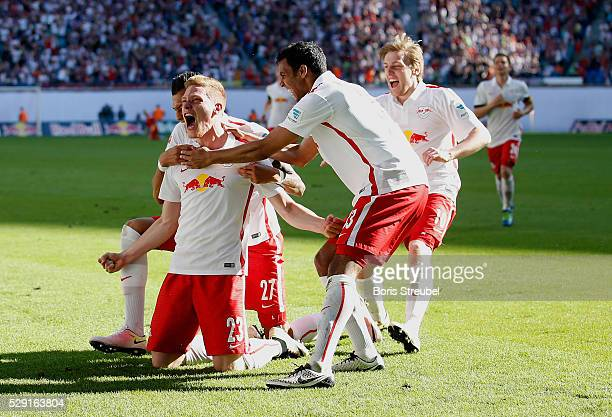 Marcel Halstenberg of Leipzig celebrates with team mates after scoring his team's second goal during the Second Bundesliga match between RB Leipzig...