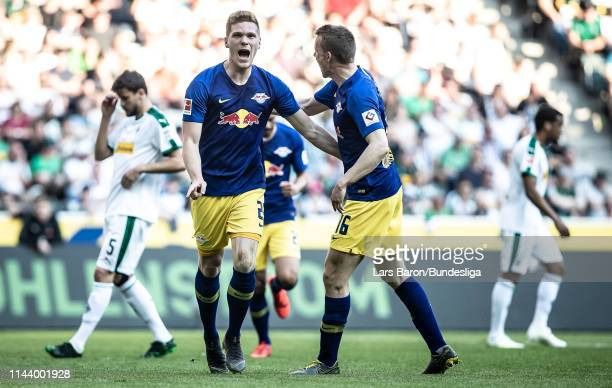 Marcel Halstenberg of Leipzig challenges after scoring his teams first goal during the Bundesliga match between Borussia Mönchengladbach and RB...