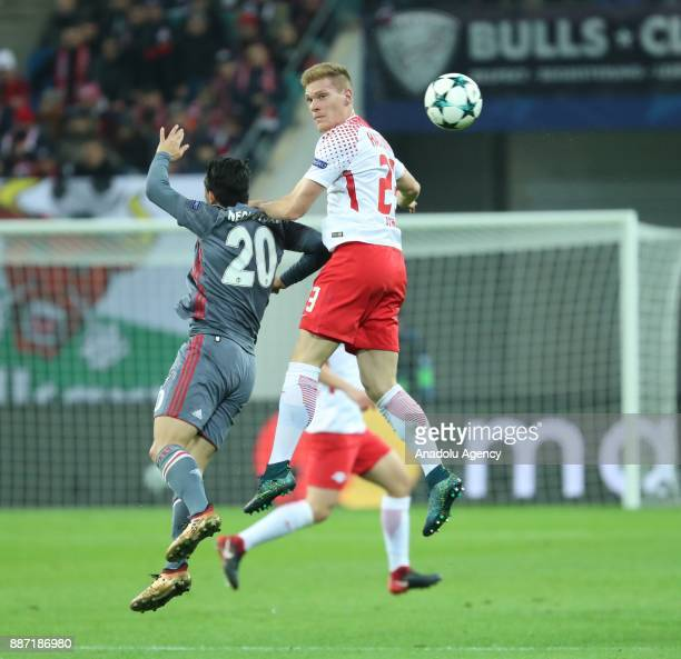 Marcel Halstenberg of Leipzig in action against Necip Uysal of Besiktas during the UEFA Champions League group G soccer match between RB Leipzig and...