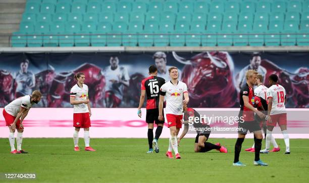 Marcel Halstenberg of Leipzig walks off the pitch after he gets the yellow red card during the Bundesliga match between RB Leipzig and Hertha BSC at...