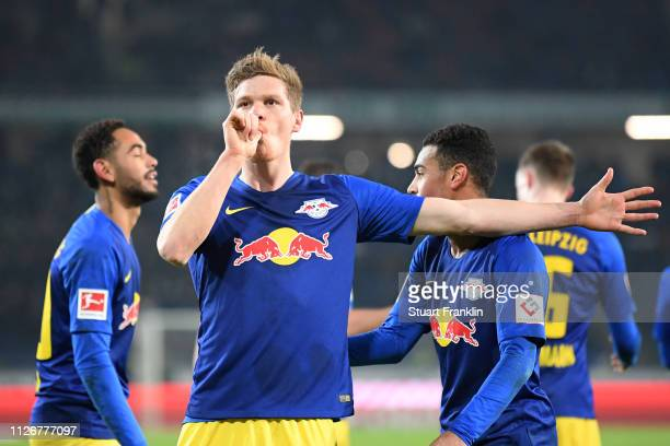 Marcel Halstenberg of RB Leipzig celebrates after scoring his team's first goal from the penalty spot during the Bundesliga match between Hannover 96...