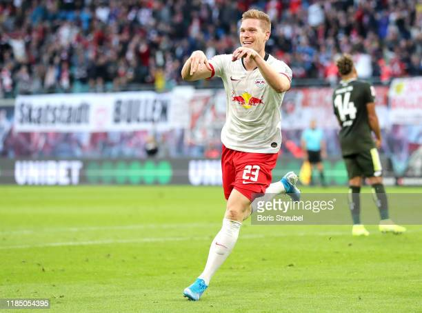 Marcel Halstenberg of RB Leipzig celebrates after scoring his team's fourth goal during the Bundesliga match between RB Leipzig and 1. FSV Mainz 05...