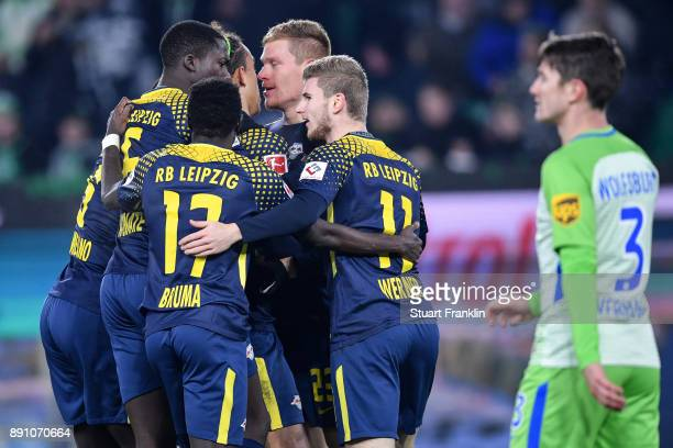 Marcel Halstenberg of RB Leipzig celebrates with his team mates after scoring the equalizing goal to make it 11 during the Bundesliga match between...