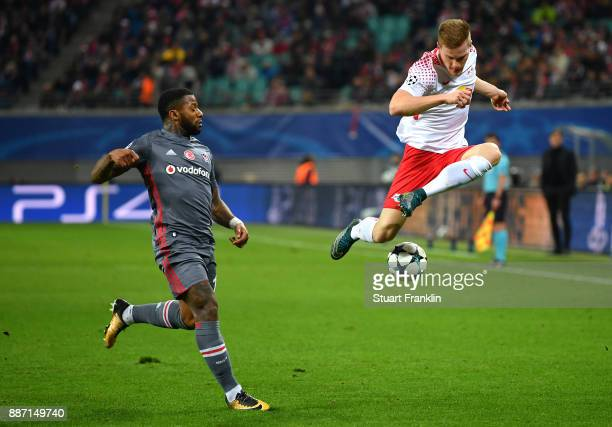 Marcel Halstenberg of RB Leipzig crosses while under pressure from Jeremain Lens of Besiktas during the UEFA Champions League group G match between...