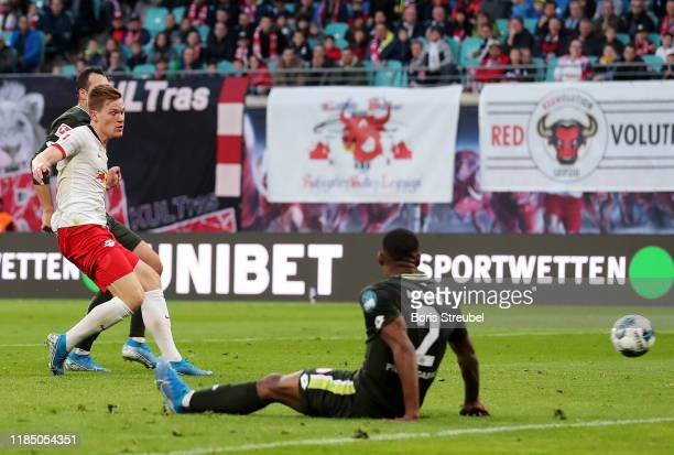 Marcel Halstenberg of RB Leipzig scores his team's fourth goal during the Bundesliga match between RB Leipzig and 1. FSV Mainz 05 at Red Bull Arena...