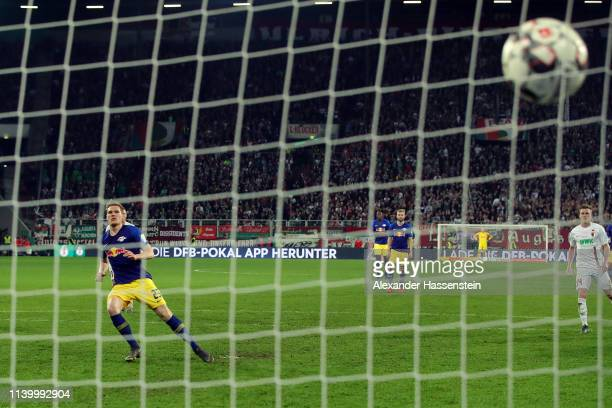 Marcel Halstenberg of RB Leipzig scores their second goal from the penalty spot during the DFB Cup match between FC Augsburg and RB Leipzig at...