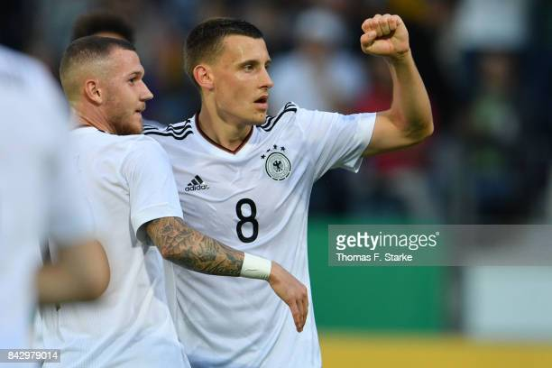 Marcel Hartel and Maximilian Eggestein of Germany celebrate during the UEFA Euro 2019 Qualifier match between Germany U21 and Kosovo U21 at Osnatel...