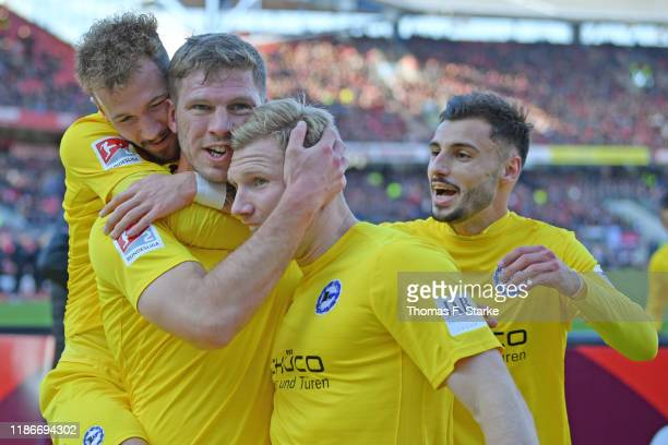 Marcel Hartel Fabian Klos Andreas Voglsammer and Jonathan Clauss of Bielefeld celebrate their teams third goal during the Second Bundesliga match...