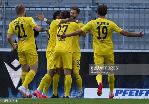 Marcel Hartel of Arminia Bielefeld is congratulated after scoring the first goal during the Second Bundesliga match between Karlsruher SC and DSC...