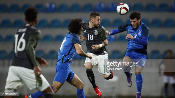 Marcel Hartel of Germany is challenged by Sertan Tashgin and Bahlul Mustafazade of Azerbaijan during the UEFA Under21 Euro 2019 Qualifier match...