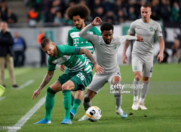 Marcel Heister of Ferencvarosi TC competes for the ball with Cicinho of PFC Ludogorets 1945 before Isael da Silva Barbosa of Ferencvarosi TC during...