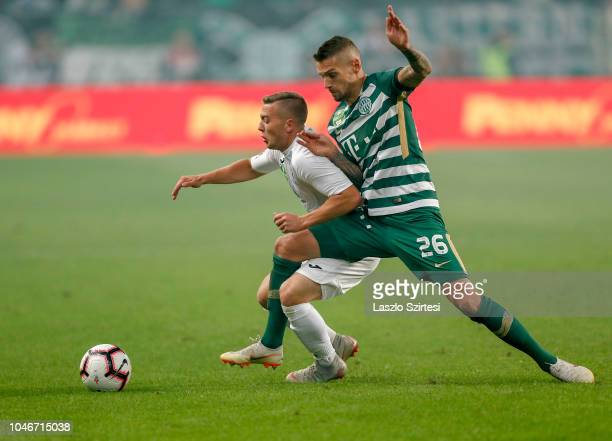 Marcel Heister of Ferencvarosi TC fouls Donat Zsoter of Ujpest FC during the Hungarian OTP Bank Liga match between Ferencvarosi TC and Ujpest FC at...