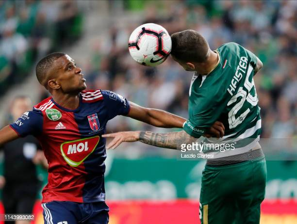 Marcel Heister of Ferencvarosi TC wins the ball in the air from Loic Nego of MOL Vidi FC during the Hungarian OTP Bank Liga match between...