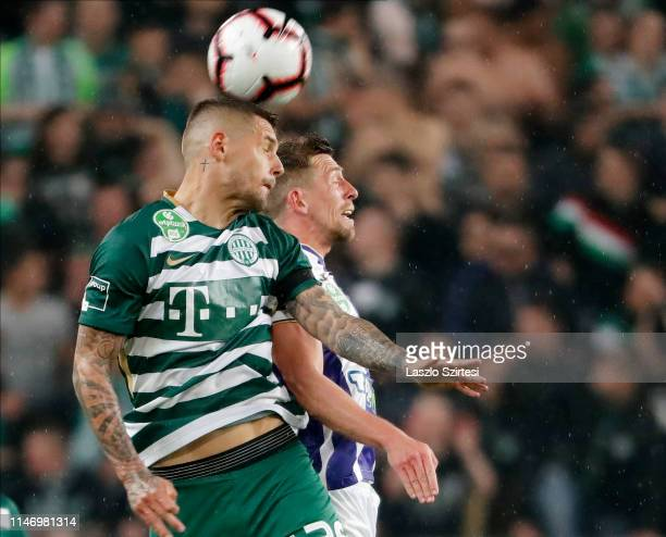 Marcel Heister of Ferencvarosi TC wins the ball in the air from Krisztian Simon of Ujpest FC during the Hungarian OTP Bank Liga match between...