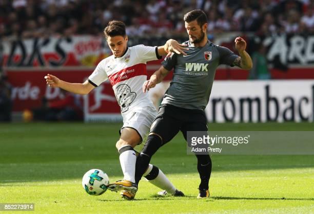 Marcel Heller of Augsburg challenges Josip Brekalo of VfB Stuttgart during the Bundesliga match between VfB Stuttgart and FC Augsburg at MercedesBenz...