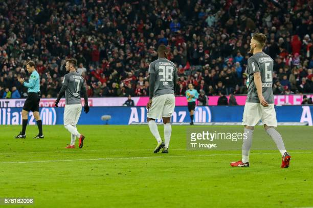 Marcel Heller of Augsburg Kevin Danso of Augsburg Jeffrey Gouweleeuw of Augsburg looks dejected during the Bundesliga match between FC Bayern...