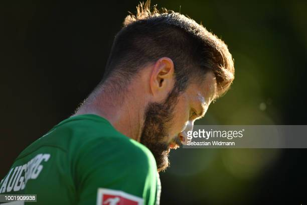 Marcel Heller of Augsburg looks down during the preseason friendly match between SC Olching and FC Augsburg on July 19 2018 in Olching Germany
