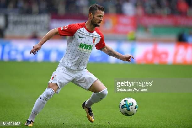 Marcel Heller of Augsburg plays the ball during the Bundesliga match between FC Augsburg and 1 FC Koeln at WWKArena on September 9 2017 in Augsburg...