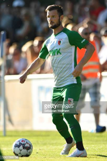 Marcel Heller of Augsburg plays the ball during the preseason friendly match between SC Olching and FC Augsburg on July 19 2018 in Olching Germany