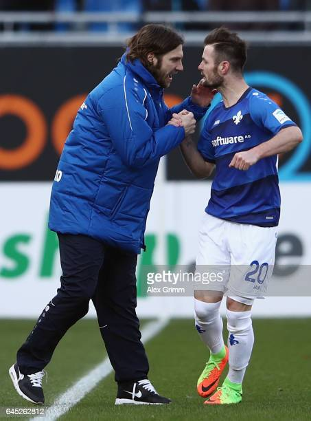 Marcel Heller of Darmstadt celebrates his team's first goal with head coach Torsten Frings during the Bundesliga match between SV Darmstadt 98 and FC...
