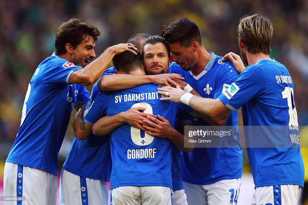 Marcel Heller (C) of Darmstadt celebrates his team's first goal with team mates during the Bundesliga match between Borussia Dortmund and SV Darmstadt 98 at Signal Iduna Park on September 27, 2015 in Dortmund, Germany.