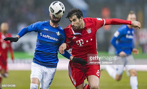 Marcel Heller of Darmstadt challenges Javi Martinez of Bayern Muenchen during to the Bundesliga match between SV Darmstadt 98 and Bayern Muenchen at...