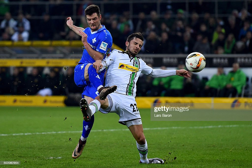Marcel Heller of Darmstadt scores his teams first goal against Julian Korb of Moenchengladbach during the Bundesliga match between Borussia Moenchengladbach and SV Darmstadt 98 at Borussia-Park on December 20, 2015 in Moenchengladbach, Germany.