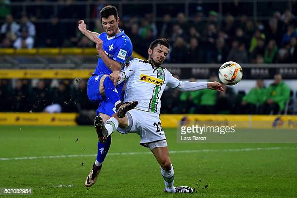 Marcel Heller of Darmstadt scores his teams first goal against Julian Korb of Moenchengladbach during the Bundesliga match between Borussia...