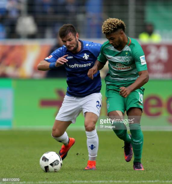 Marcel Heller of Darmstadt Serge Gnabry of Bremen battle for the ball during the Bundesliga match between SV Darmstadt 98 and Werder Bremen at...